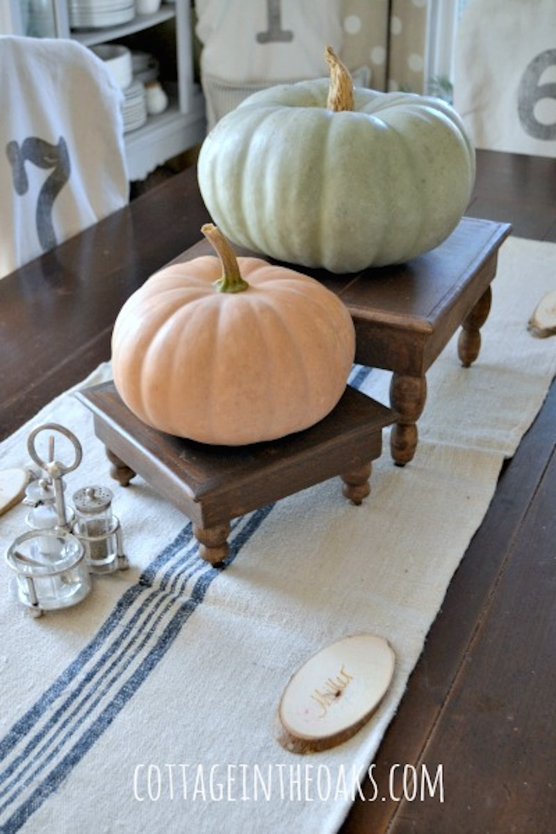 3-pumpkins-on-cheese-tables