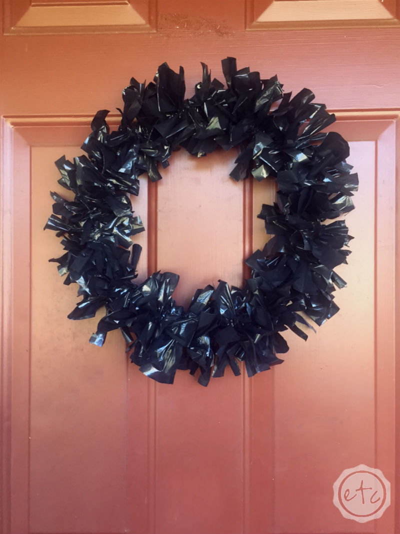 How to Make a Fun Halloween Wreath with a Coat Hanger and Hefty Trash Bags!