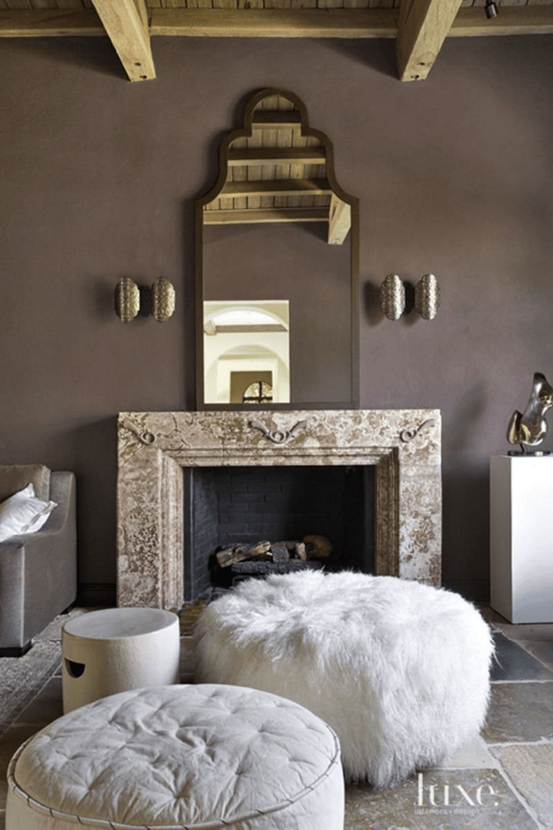 2 poised-taupe-living-room-with-fireplace-and-pouf-ottomans-min