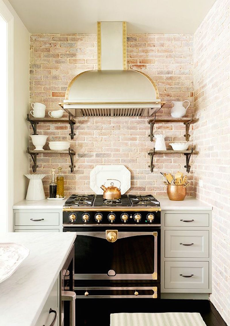 This little kitchen doesnt have much copper at all just a few accents to add warmth especially with the rough brick its such a classy combination of