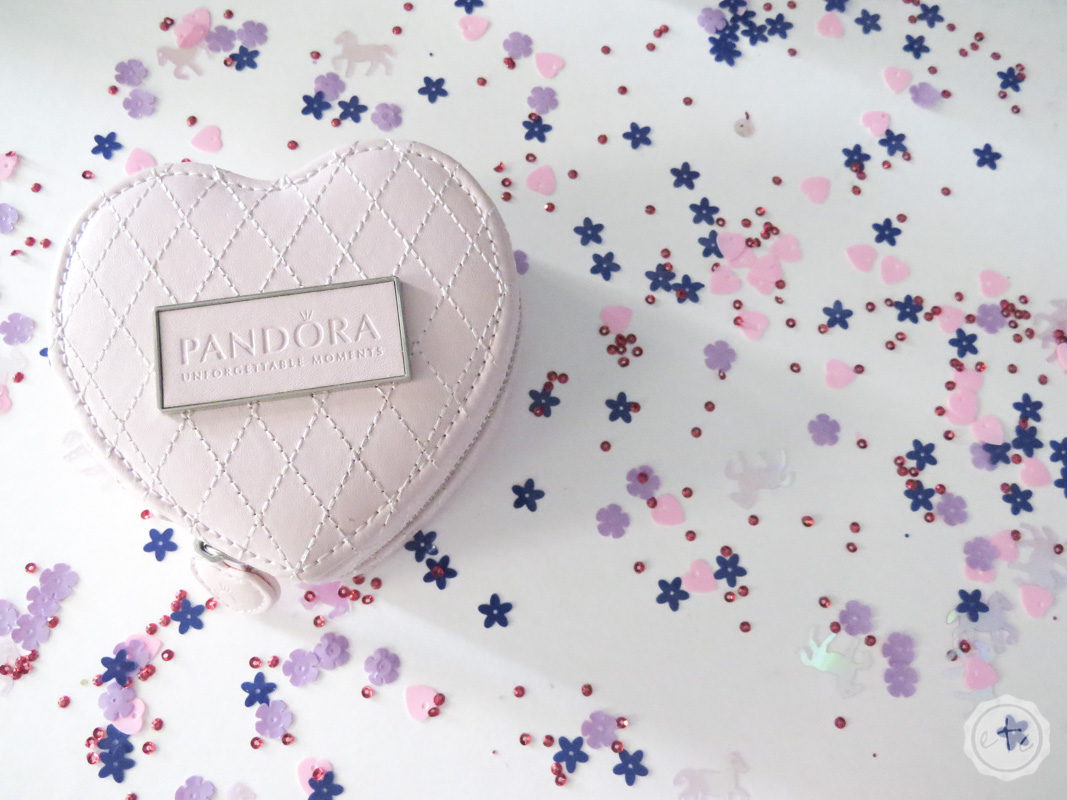A small heart shaped Pandora jewelry box with beautiful stiched detailing on blush leather