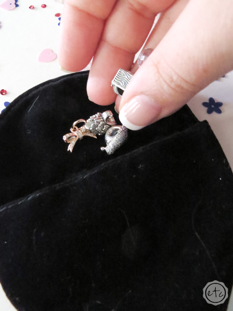 Putting charms inside this little pandora jewelry pouch