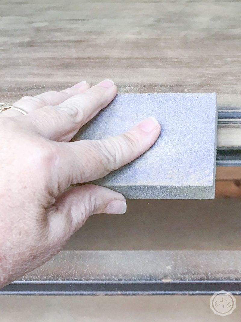 How to sand your piece with a sanding block before using furniture paint