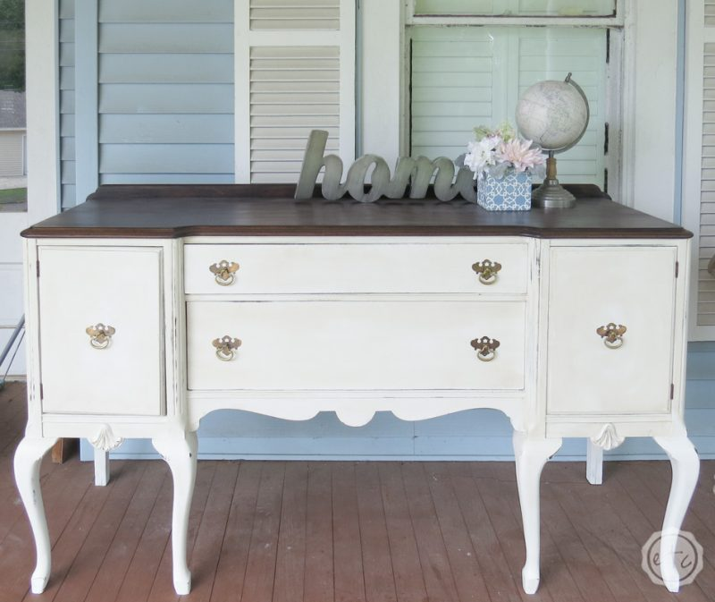 A large buffet painted in rustoleum linen white chalk paint with a minwax dark walnut stained top.