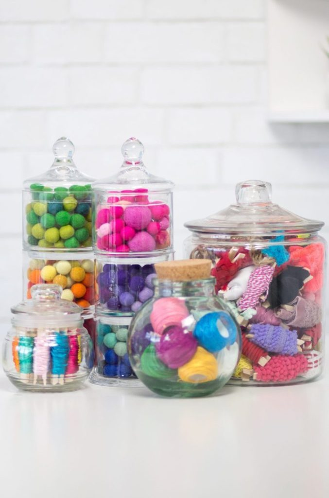 Craft Room Organization Ideas: Clear Glass Storage Jars filled with craft supplies