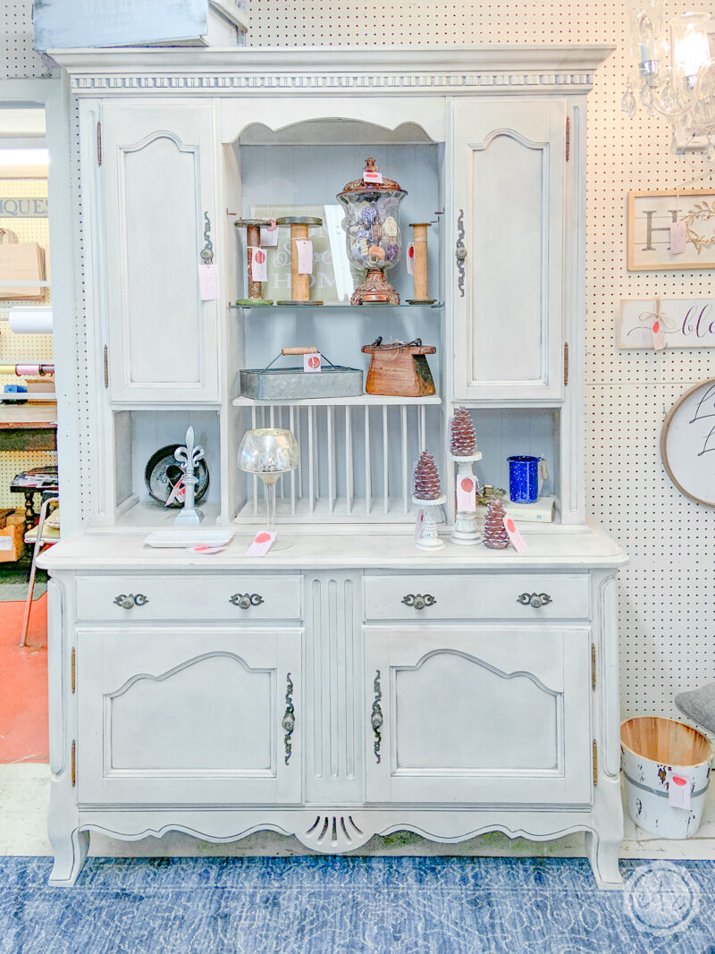 A large white hutch that was painted with furniture paint.