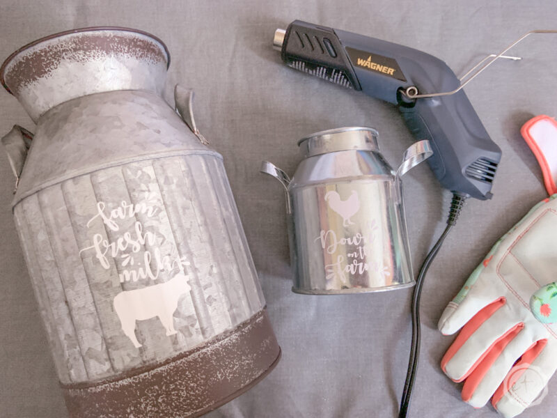 Two metal milk canisters with iron on decals, my wagner heat gun and digz leather work gloves.