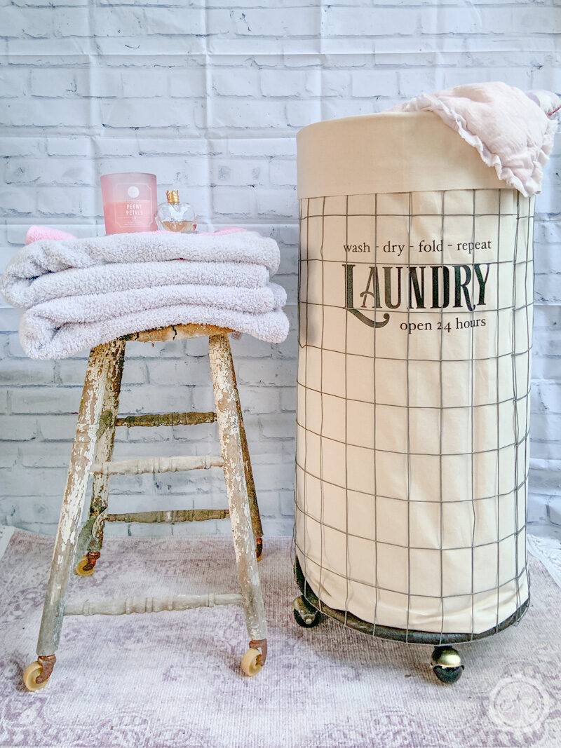 The finished laundry bin styled with linens