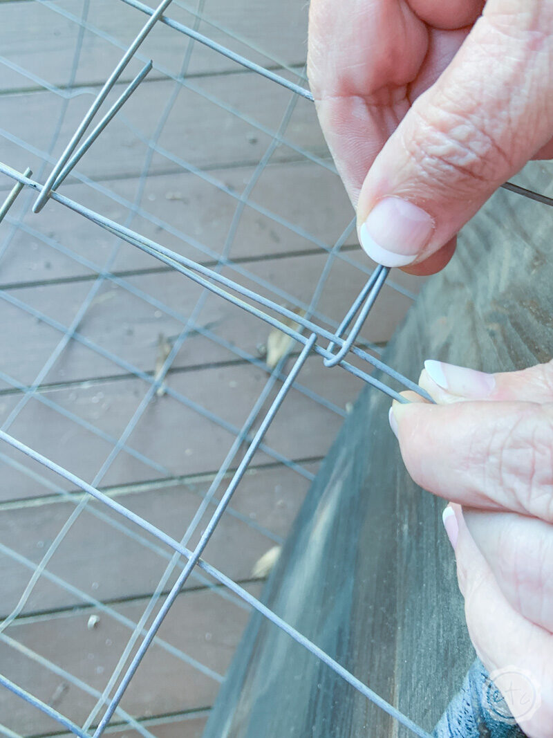 Folding over the wire portion of a length of wire fencing to create a wire cage.