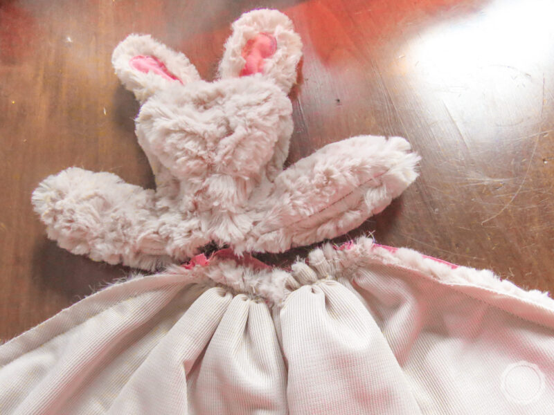 The completed bunny head with the blanket (inside out) before attaching the two pieces.